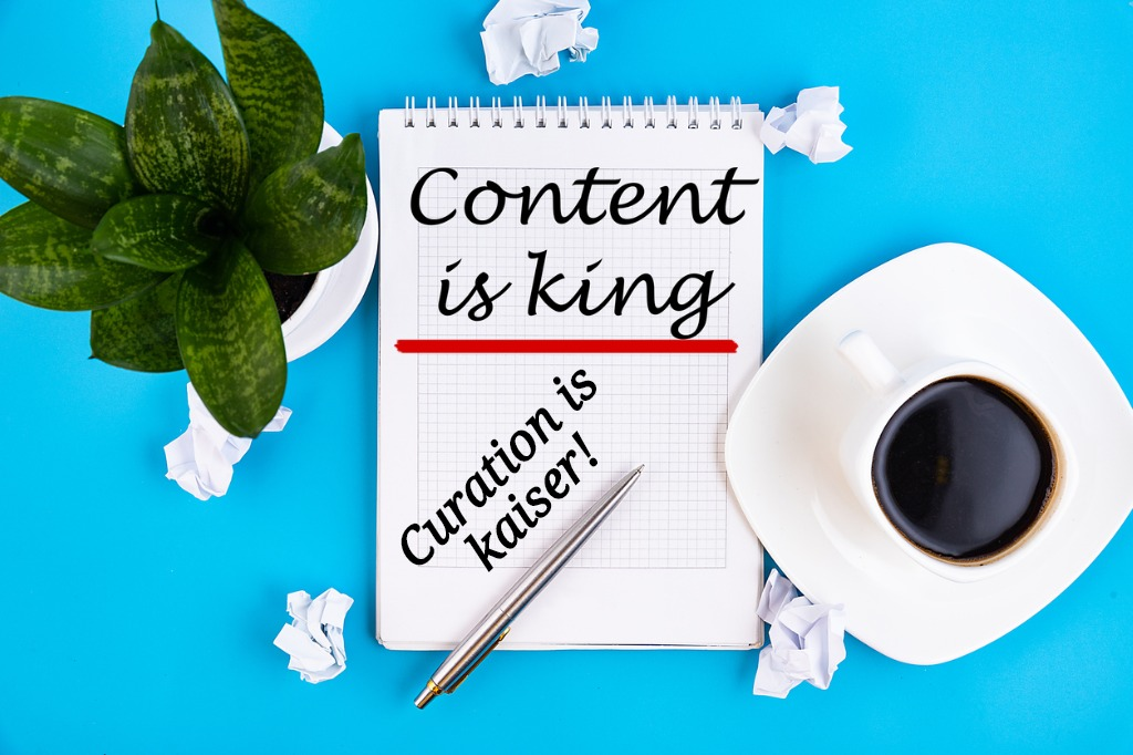 content-is-king-handwriting-on-a-notebook-with-pen-and-a-cup-of-picture-id1221777478